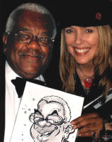 Luisa with Sir Trevor McDonald